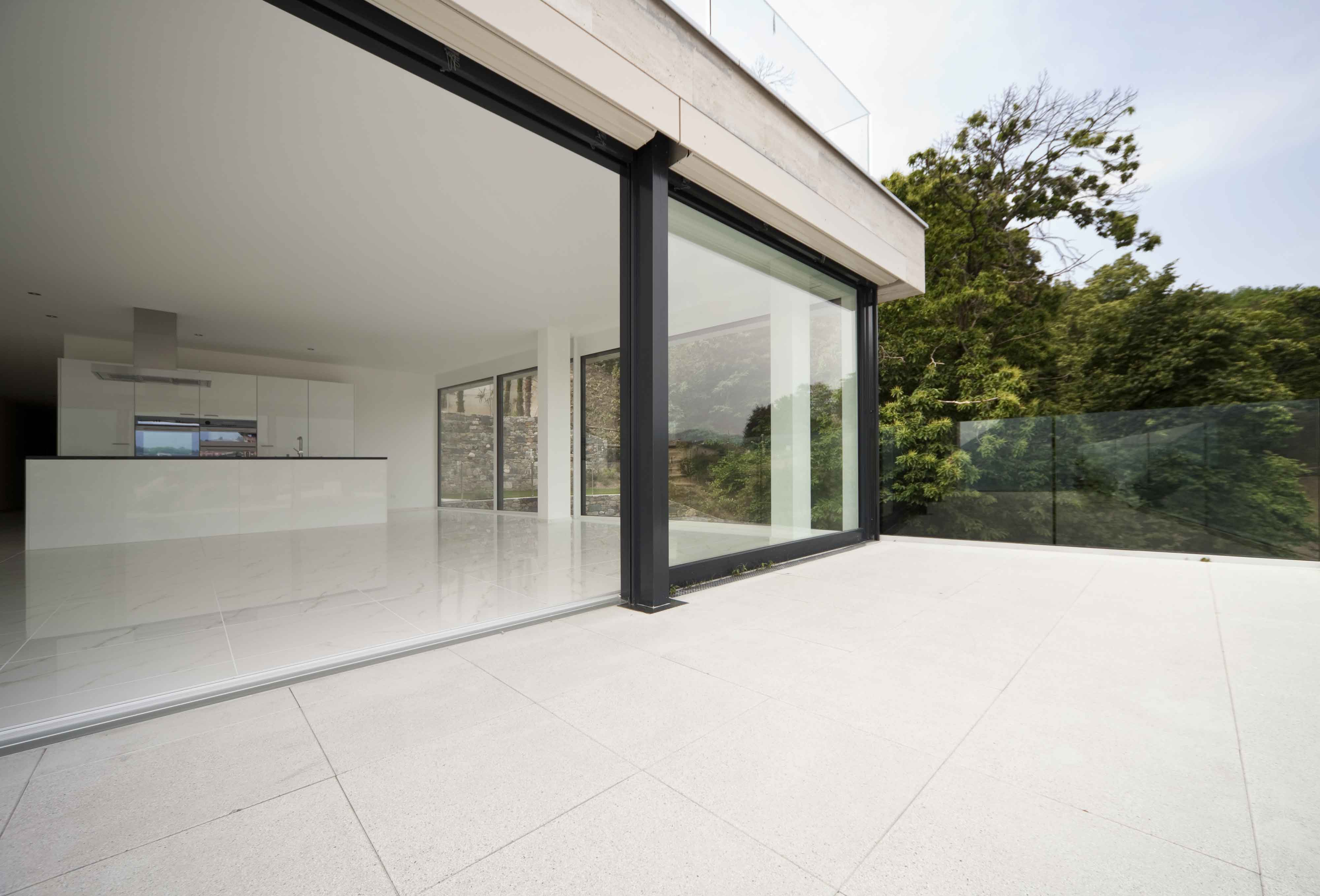 Open kitchen extension with glass door leading out to the exterior