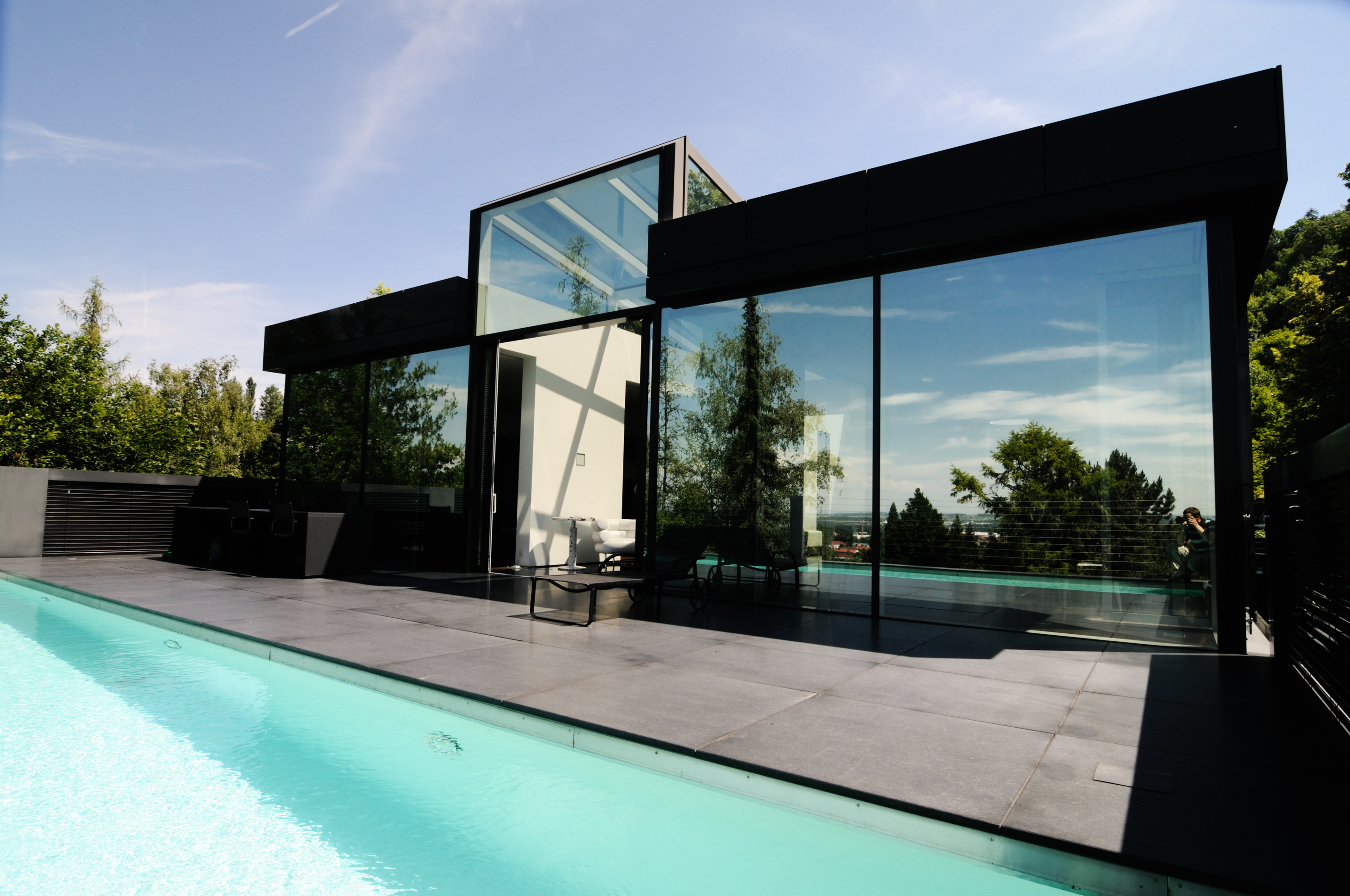 modern home with granite front and bright pool...